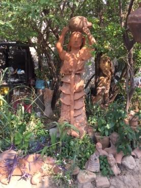 Jose clay woman in garden