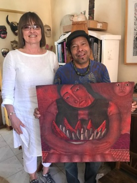 Sandra with Fernando Olvera with a painting she bought.