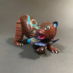 Bear eating fish Carved and painted wood