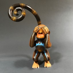 Carved and painted wood monkey