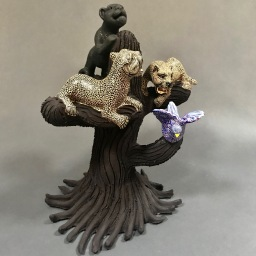Tree, jaguar and dove