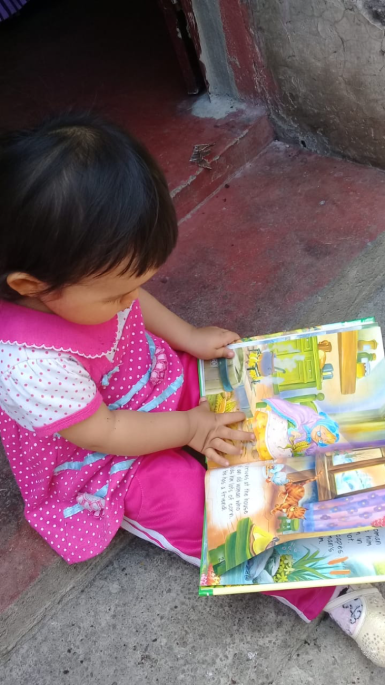 Baby Susan with her book
