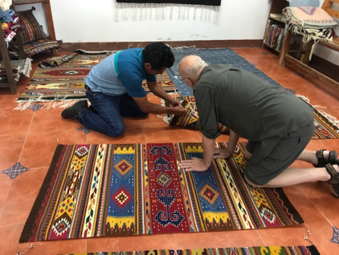 Mayer selecting rugs