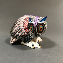 Carved and painted wood owl by Franco Ramírez