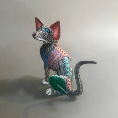 Carved and painted wood wildcat by Franco Ramírez