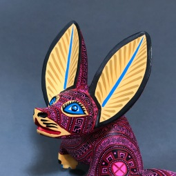 Carved and painted wooden fox by Franco R