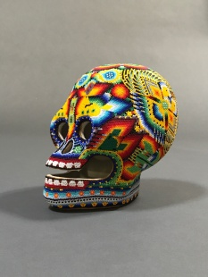 Huichol art skull side view